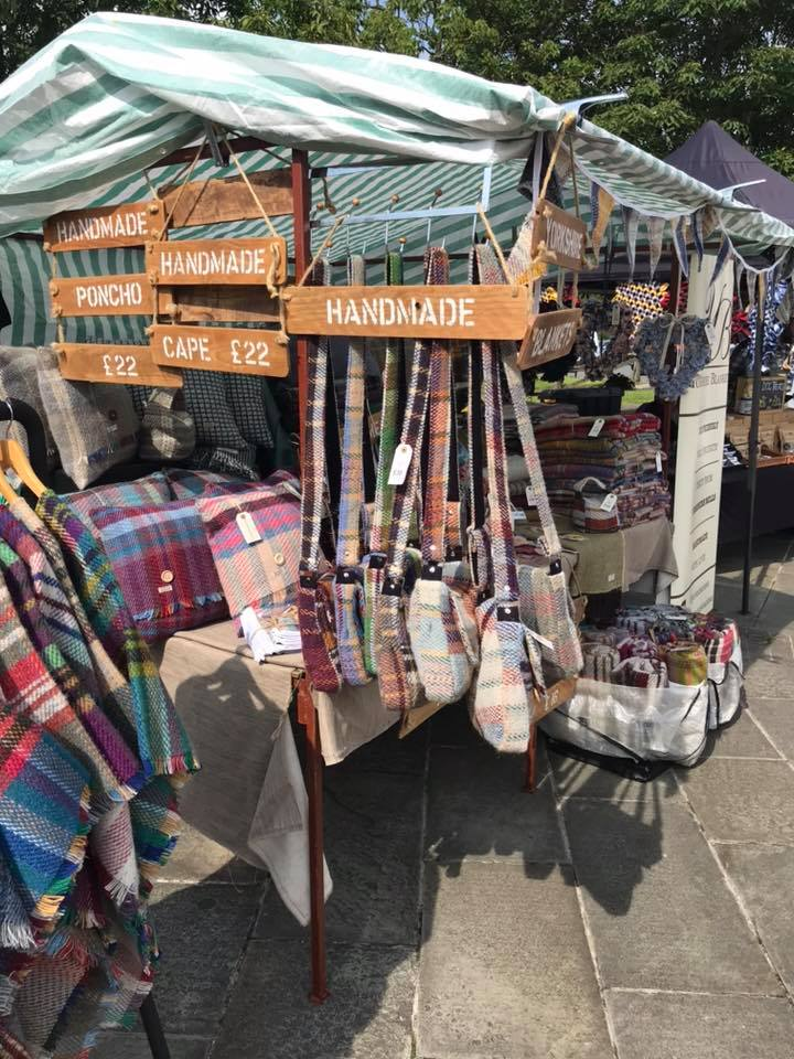 A market stall selling blankets