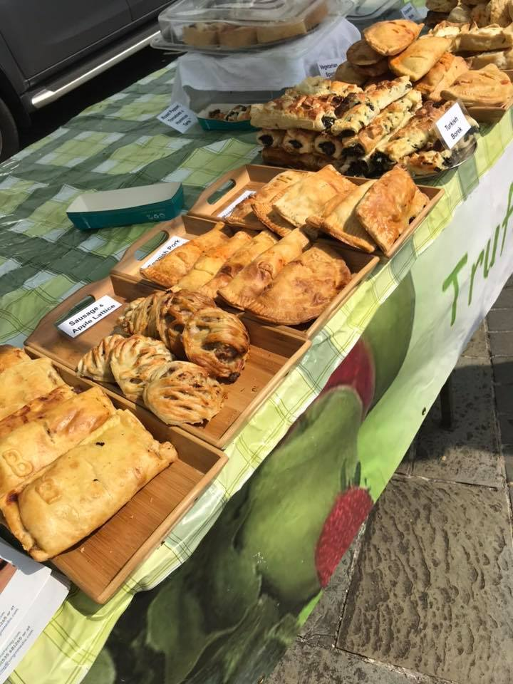A picture of a market stall selling pastries