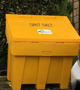 Picture of grit bin with the green and purple logo of Bingley town council on it