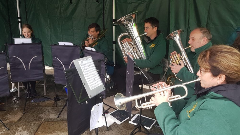 5 musicians playing brass instruments